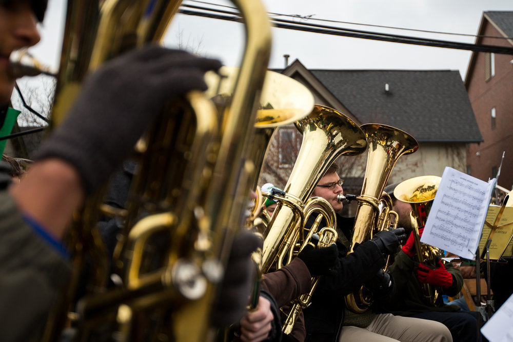 People play Christmas music during the annual Tuba Christmas event at the Ann Arbor Farmers Market in Kerrytown on Sunday, December 4, 2016. A record 62 people made up this years Tuba Christmas band, ranging from high school students, to retirees. Matt Weigand | The Ann Arbor News