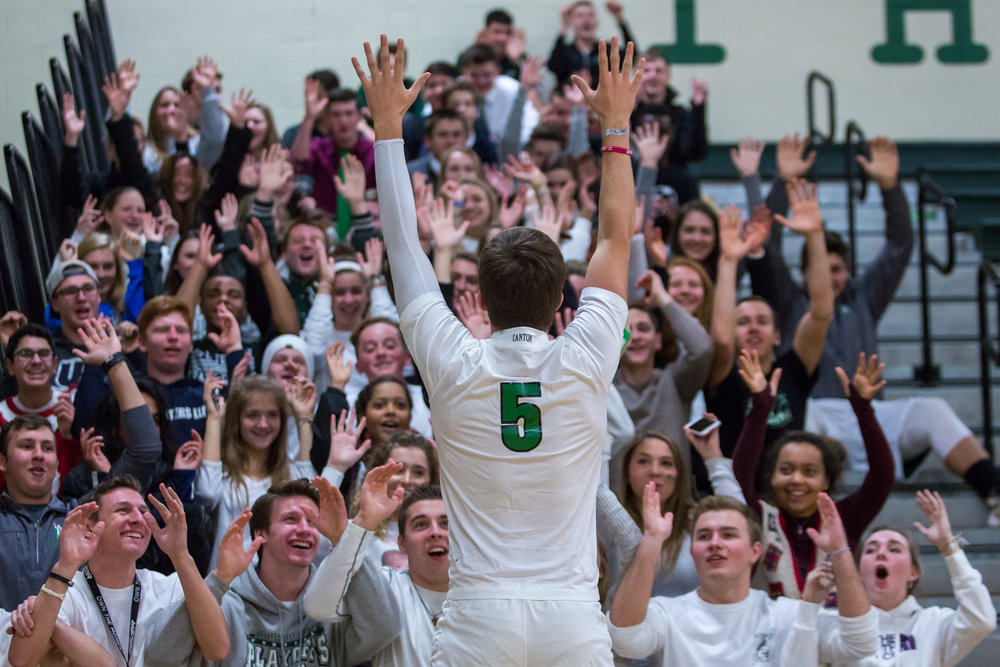 Jack Gaderick, Ann Arbor Gabriel Richard High School senior, leads a cheer with the rest of the students during a timeout at Ann Arbor Gabriel Richard High School on Friday, December 9, 2016. Chelsea High School beat Ann Arbor Gabriel Richard High School 66-49. Matt Weigand | The Ann Arbor News