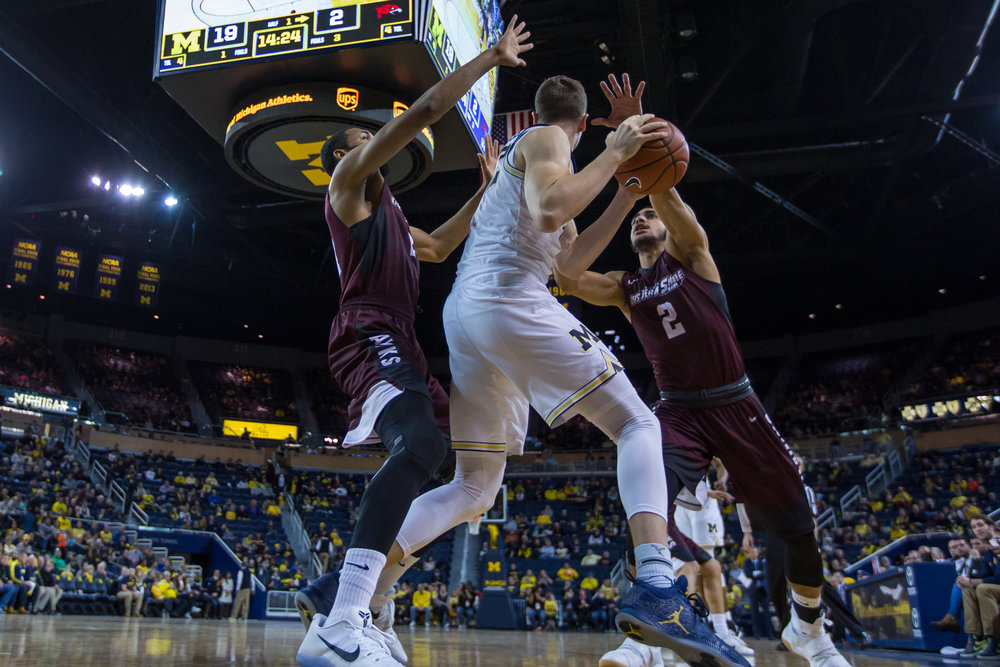 Michigan�s Duncan Robinson (22) gets double teamed by two Maryland Eastern Shore defenders during the first half of play at the Crisler Center on Saturday, December 17, 2016. Michigan leads Maryland Eastern Shore 49-22 at half. Matt Weigand | The Ann Arbor News