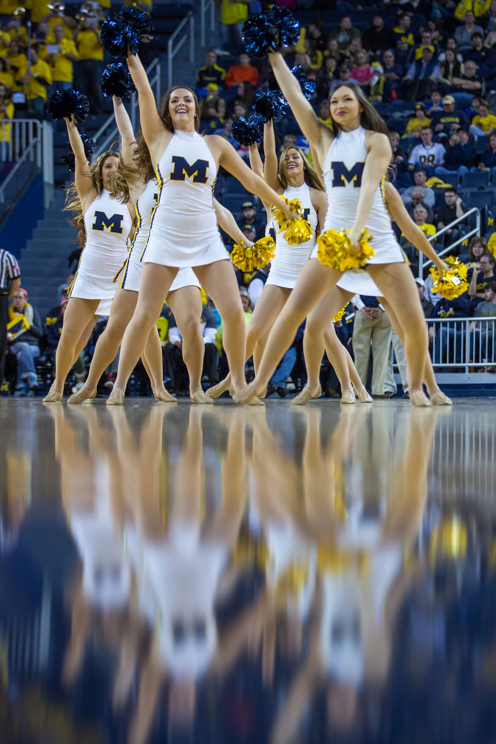 The Michigan dance team dances during a timeout during the second half of play at the Crisler Center on Saturday, December 17, 2016. The Michigan Wolverines beat the Maryland Eastern Shore Hawks 98-49. Matt Weigand | The Ann Arbor News