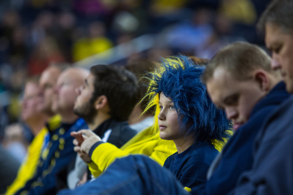 A Michigan fan watches the game during the second half of play at the Crisler Center on Saturday, December 17, 2016. The Michigan Wolverines beat the Maryland Eastern Shore Hawks 98-49. Matt Weigand | The Ann Arbor News