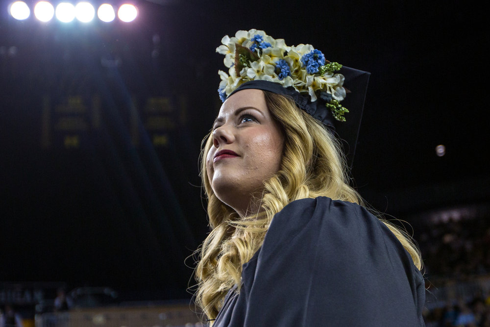 A graduating student looks un into the crowd to locate her family before walking onto stage during the University of Michigan winter commencement at the Crisler Arena on Sunday, December 18, 2016. About 1,000 other students graduated at the Crisler Arena on Sunday. Matt Weigand | The Ann Arbor News