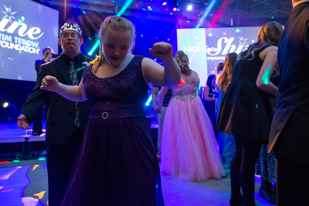 Ruby Hancock, front, dances with her boyfriend Peter at 2 | 42 Community Church for the Night to Shine on Friday, February 10, 2017. Night to Shine, sponsored by the Tim Tebow Foundation, is a special needs prom for anyone aged 14 and older and occurs at hundreds of locations around the country. Matt Weigand | The Ann Arbor News