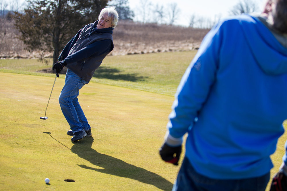 Leon Dillon, left and Rick Polmounter react after Dillon misses a putt on the 15th green while golfing at Rustic Glen Golf Club in Saline on Friday, February 16, 2017. Due to the unseasonably warm weather, local golf courses are beginning to open for golfing. Matt Weigand | The Ann Arbor News