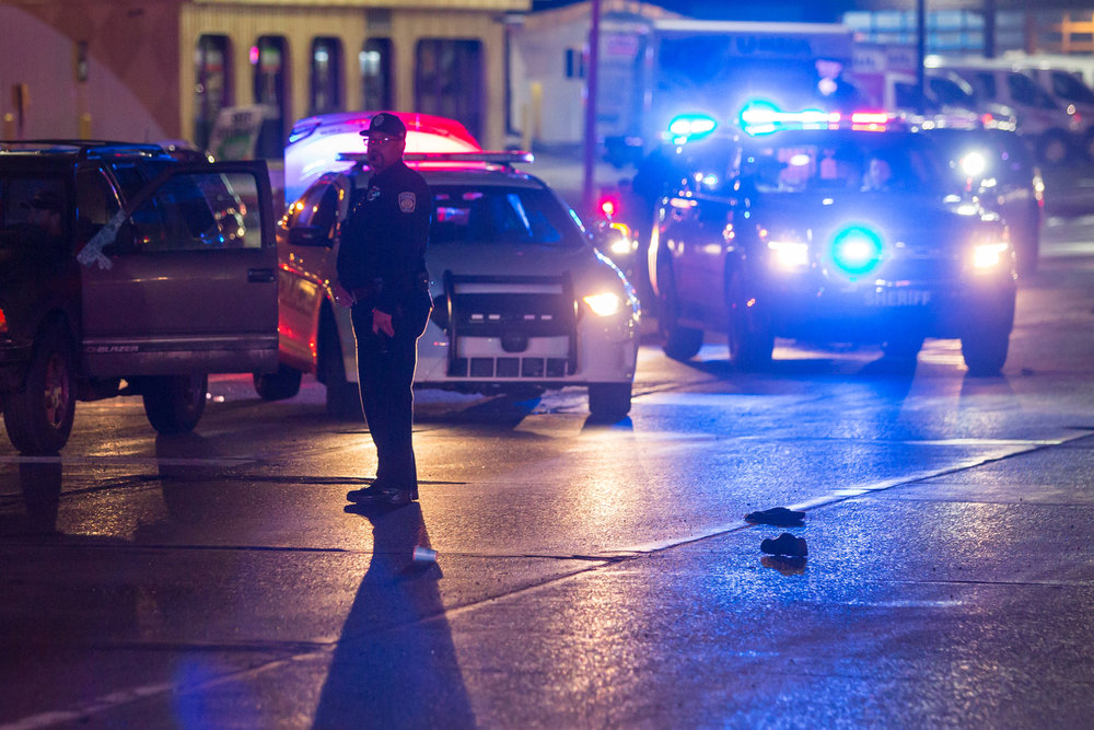 A police officer watches traffic slowly pass on Washtenaw Avenue near Boston Avenue after a pedestrian was hit by a passing motorist on the evening of Friday, February 24, 2017. The incident is still under investigation. Matt Weigand | The Ann Arbor News