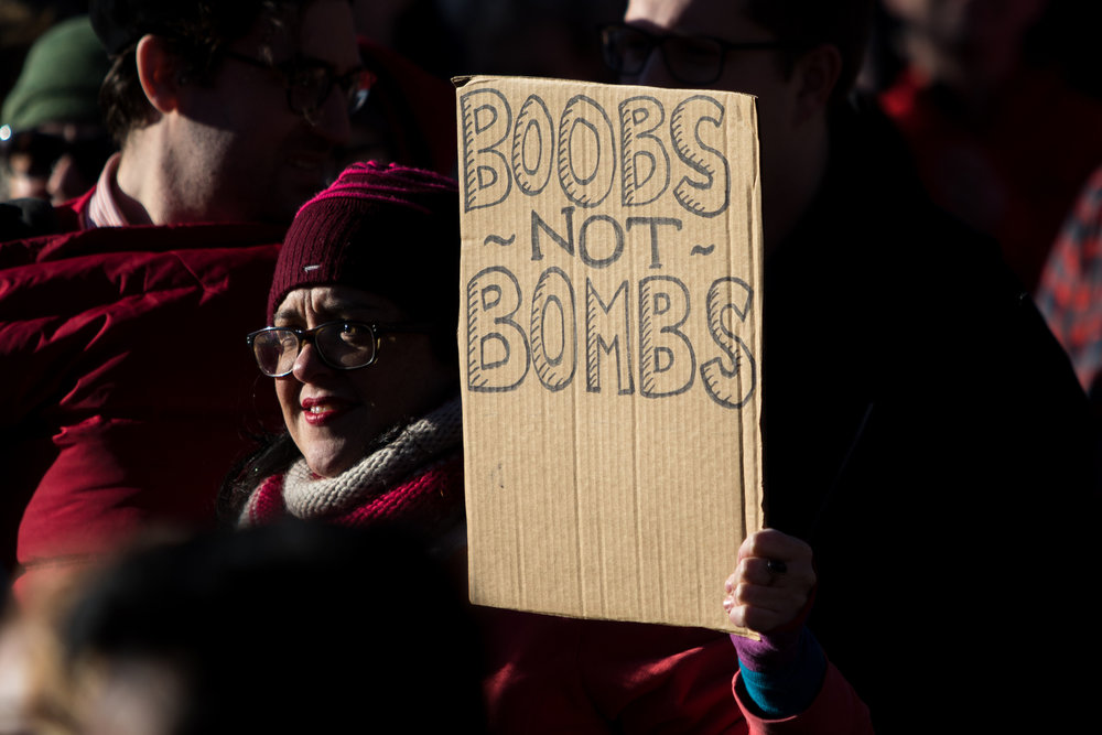 A woman holds a sign during the women's strike and gathering at Liberty Plaza on Wednesday, March 8, 2017. The march was part of an international gathering and movement for women's rights. Matt Weigand | The Ann Arbor News