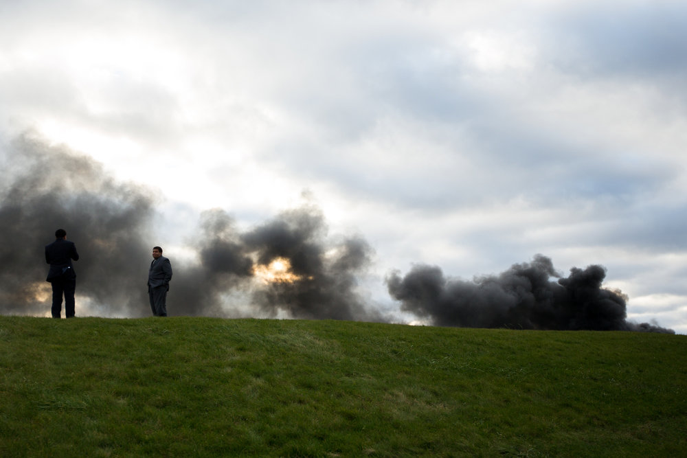 Two men stand atop a hill overlooking GLR Recycling Solutions near Salem Township where a fire at the recycling plant broke out on the afternoon of Sunday, November 20, 2016. Multiple fire departments have responded and there is not yet a cause for the fire.