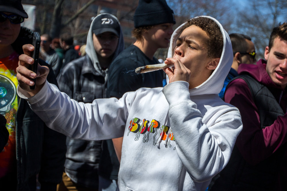 Preston Carter takes a selfie while smoking a joint at the University of Michigan for the 46th annual Hash Bash on Saturday, April 1, 2017. Hash Bash began in 1972 and each year has gotten bigger and pushed to legalize marijuana. Matt Weigand | The Ann Arbor News