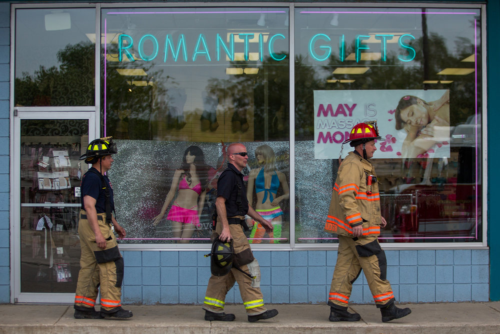 Multiple fire departments respond to reports of smoke at Lovers Lane adult store on Washtenaw Avenue in Ypsilanti on Wednesday, May 17, 2017. The incident is still under investigation. Matt Weigand | The Ann Arbor News