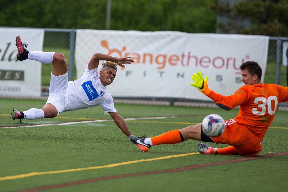 AFC Ann Arbor's Dario Suarez (7) scores a goal during the 40th minute during their matchup against Detroit City FC at Hollway Field at Pioneer High School on Sunday, May 21, 2017. AFC Ann Arbor beat Detroit City FC 2-0. Matt Weigand | The Ann Arbor News
