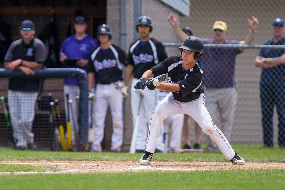 A Pioneer player bunts during the district semi finals against Saline High School at Saline High School on Saturday, June 3, 2017. Saline beat the Pioneer 5-1. Matt Weigand | The Ann Arbor News