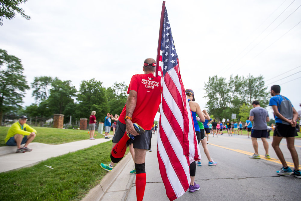 Jeff Walters of Dearborn Heights stretches before the beginning of the Dexter to Ann Arbor half marathon on Sunday, June 4, 2017. Thousands turned out for the event, which is in its 44th year. Matt Weigand | The Ann Arbor News