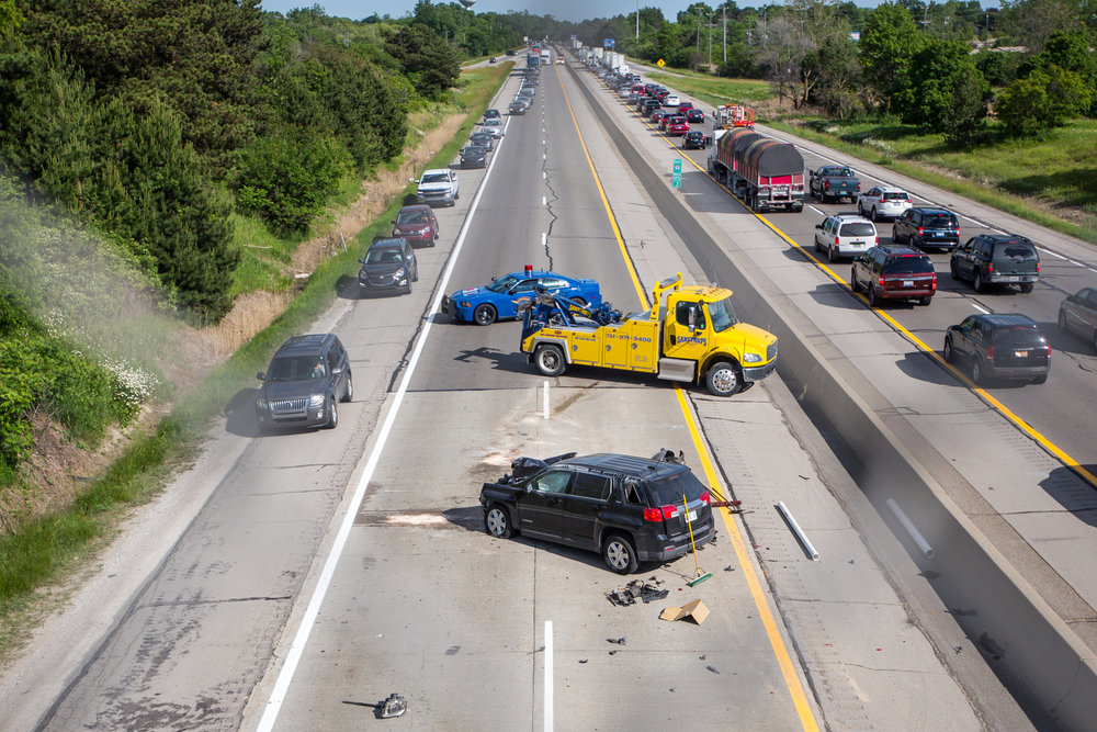 A car sits on the roadway after a three-car collision on westbound I-94 near Ann Arbor Saline Road on Thursday, June 8, 2017. No major injuries were reported. Matt Weigand | The Ann Arbor News