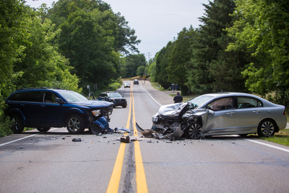 Two cars sit on Glazier Way, near the UMH Child Care Center, after a head on collision closed the road on Wednesday, June 28, 2017. The driver of the silver car swerved into the oncoming lane after looking at their GPS on their phone. Both drivers were taken to University of Michigan Hospital and neither had serious injuries. Matt Weigand | The Ann Arbor News