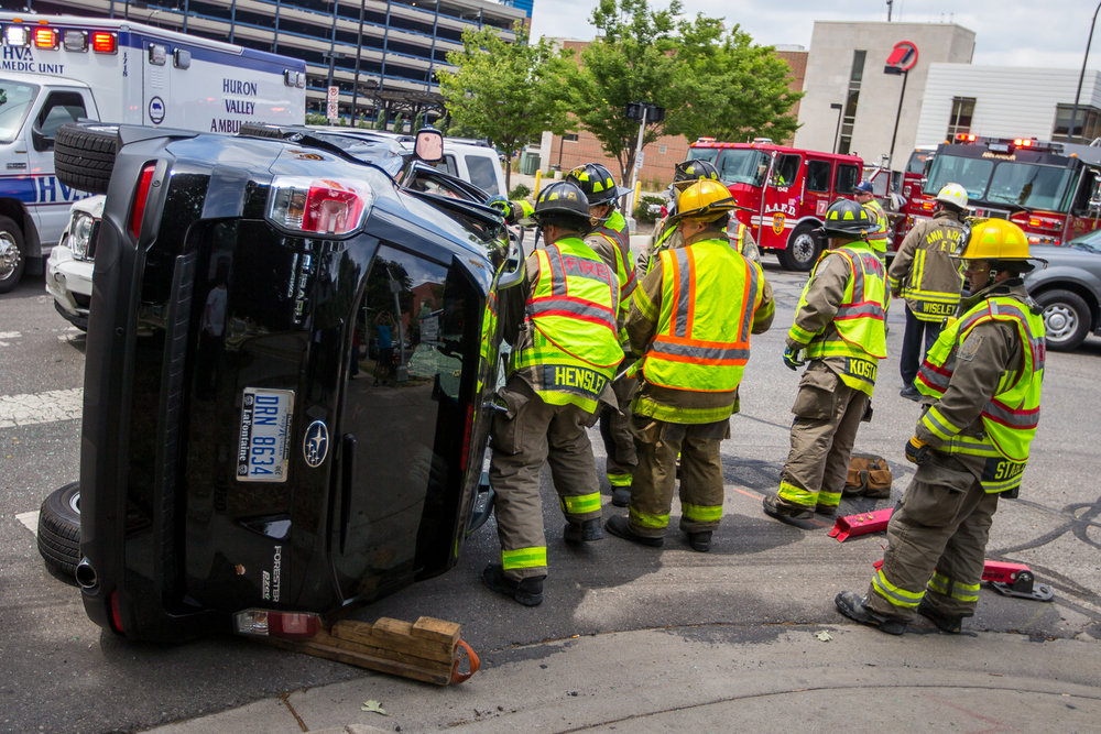 Members of the Ann Arbor Fire Department work to free two individuals from a Subaru after it was involved in a collision with a Jeep at the intersection of Fifth Avenue and East William Street on Thursday, June 29, 2017. There were no major injuries and the incident is under investigation. Matt Weigand | The Ann Arbor News