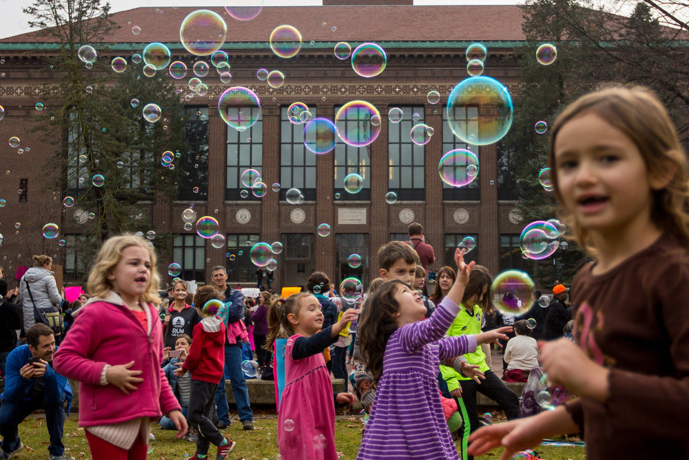 Kids play with bubbles during the Women's March at the Diag on Michigan's campus on Saturday, January 21, 2017.  The march was one of several throughout the country and drew over 6,000 people. Matt Weigand | The Ann Arbor News