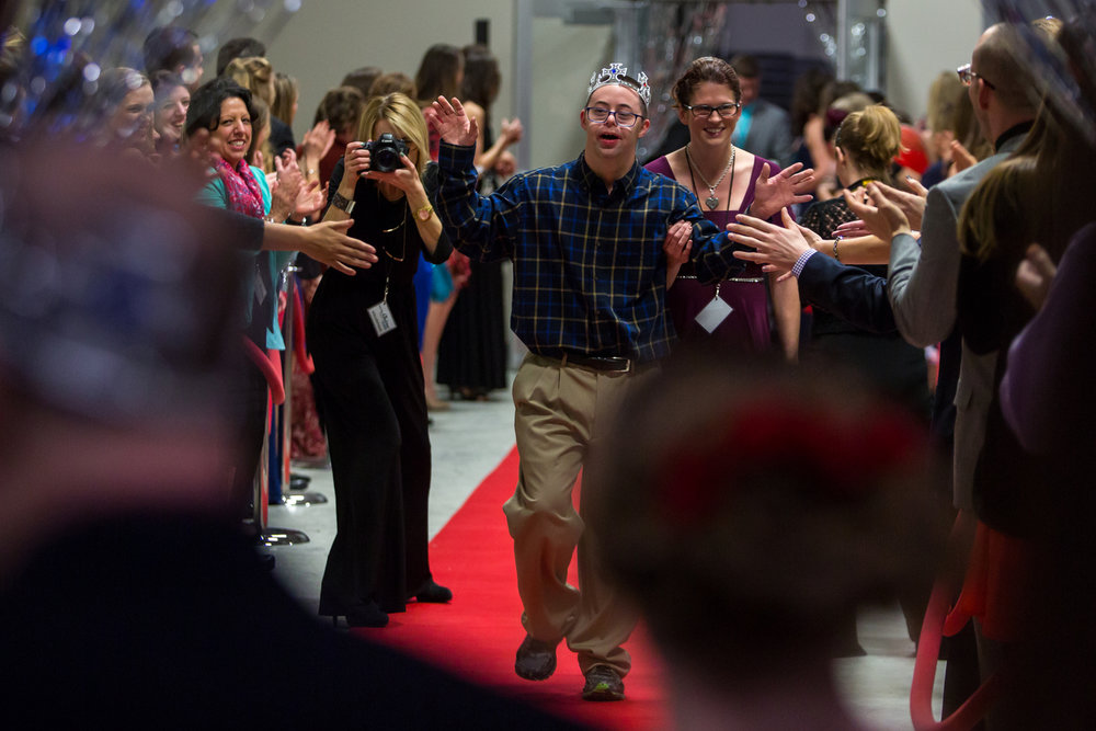 A prom attendee walks down the red carpet and high fives volunteers at 2 | 42 Community Church for the Night to Shine on Friday, February 10, 2017. Night to Shine, sponsored by the Tim Tebow Foundation, is a special needs prom for anyone aged 14 and older and occurs at hundreds of locations around the country. Matt Weigand | The Ann Arbor News