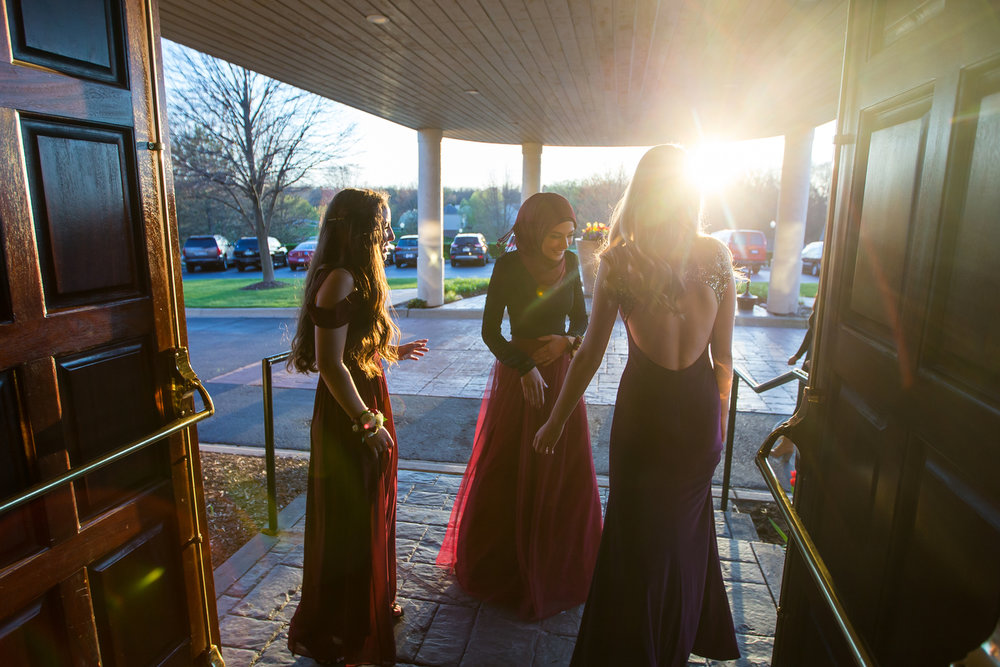 Students talk during the Washtenaw International High School prom at Polo Fields Golf and Country Club on Saturday, April 22, 2017. Matt Weigand | The Ann Arbor News