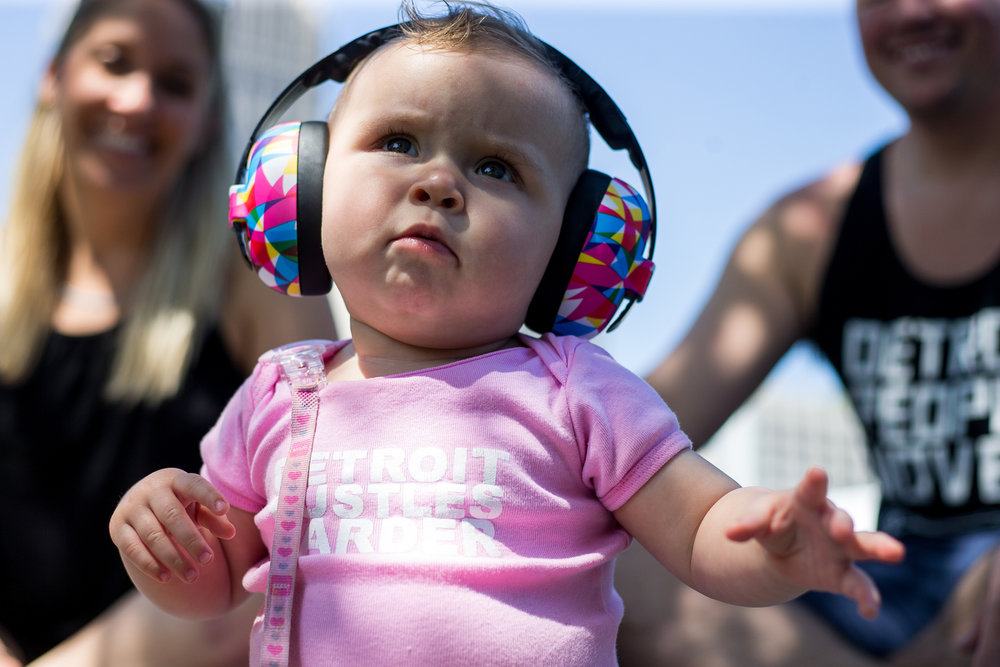 Charlotte Slack, 10-months-old, sits on the grass with her parents Julie, left and Jimmy at Hart Plaza in downtown Detroit for day one of Movement Electronic Music Festival on Saturday, May 27, 2017. Over 100 artists are scheduled to perform over the three-day Memorial Day festival. Matt Weigand | The Ann Arbor News