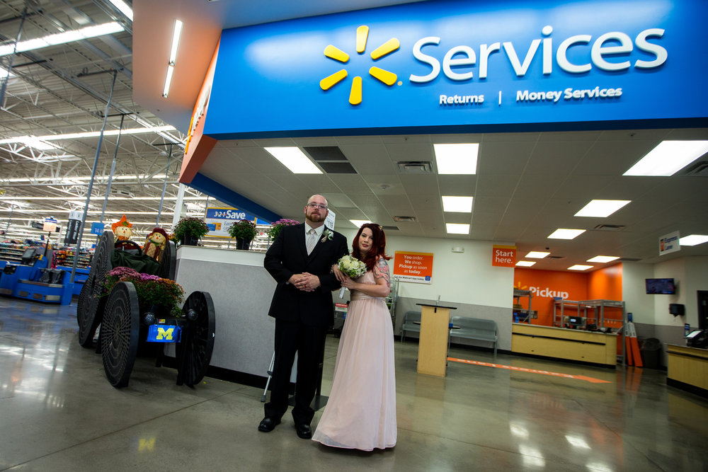 David Medford, left, poses with his wife Marissa after their wedding at the home and garden patio at Walmart in Saline on Sunday, September 24, 2017. Medford met his wife Marissa while working at a Walmart in Guilford, Connecticut about four years ago and both currently work at the Saline location. David works in the produce section and would often walk by and talk with Marissa who works at the service desk. Matt Weigand | The Ann Arbor News