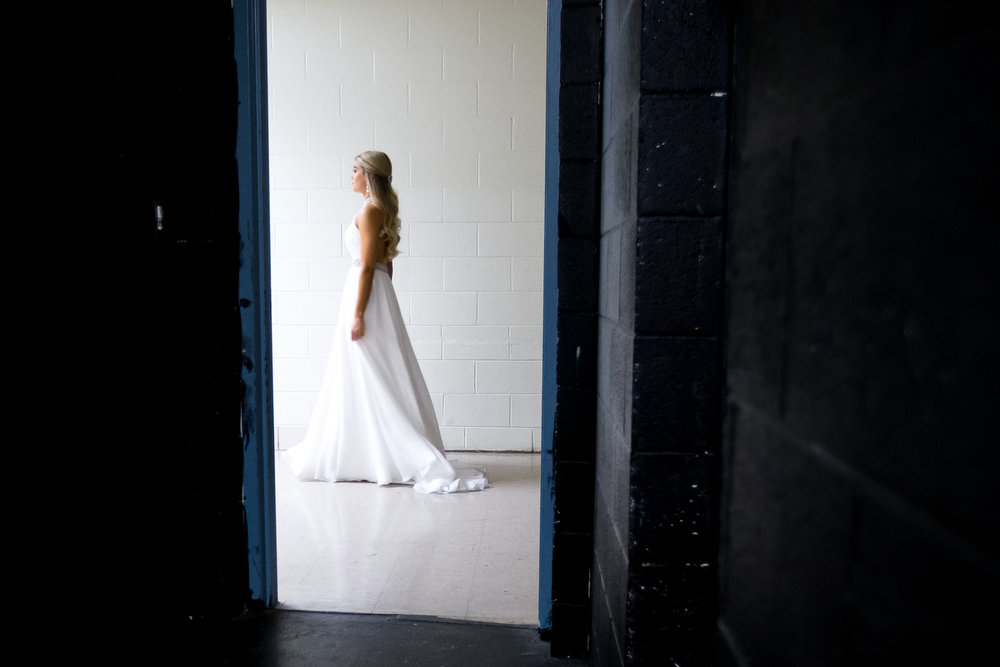 Zan Berube stands in a hallway near the stage during the Miss Washtenaw County pageant at the Washington Street Education Center in Chelsea on Saturday, October 14, 2017. The pageant is open to women between the ages of 17-24 who live, work, or attend school full time in Washtenaw or Livingston counties. Matt Weigand | The Ann Arbor News