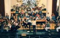 John Wilson conducts the Sinfonia of Westminster at rehearsal for the Concordia international gala showcase, 2 October 1997