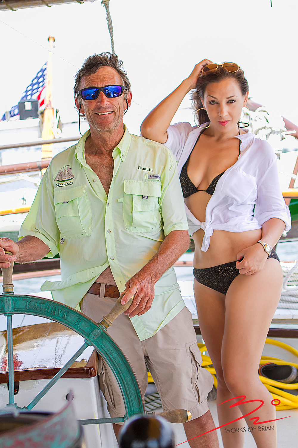 "While holding us steady on course, Captain Greg Lohse of ""The Schooner Alliance"" was kind enough to let Christina lean on him for this great shoot together."