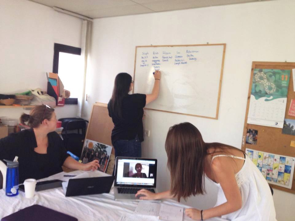 Marie from France, Adriana from the USA, Stephanie from Australia : Windows interns at the Tel Aviv-Jaffa office in a Skype conference with Leo from Germany, an intern at the Nablus office, (2013)