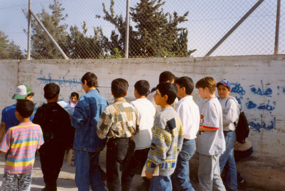 Following readers letters, Windows' young journalists went to Kalandia Refugee camp to see what it's like in their own eyes. 1996, Kalandia youth sharing their stories with Windows young team.