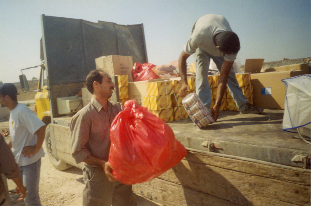 The trust between Windows' community is based, among others, on the solidarity and support shown in hard times. A truck filled with food for Tulkram refugee camp, Summer 2003.
