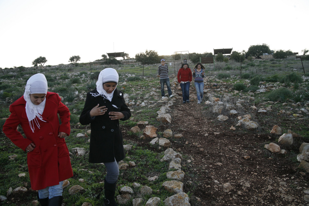 Young journalists from Jenin area, looking for the remains of their grandparents' village near Beth She'an. The stories of the refugees and the right of return are always on the table. (2011)
