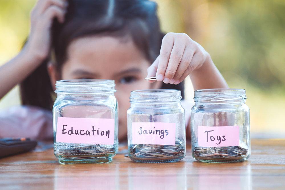 child 9 years counting money.jpg