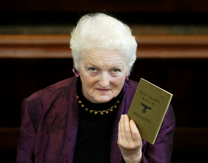 Julia Neuberger with her grandmother's J-stamped passport (Photo: Reuters)