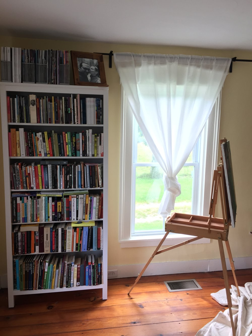 My three choices: the easel, a collection of poetry, and the groundhog visible outside the window.