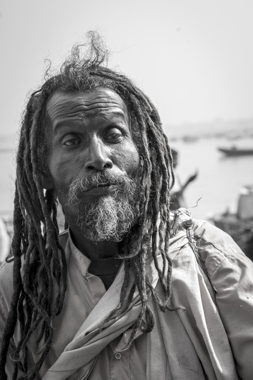 A homeless man walking around the river Ganges in Varanasi.