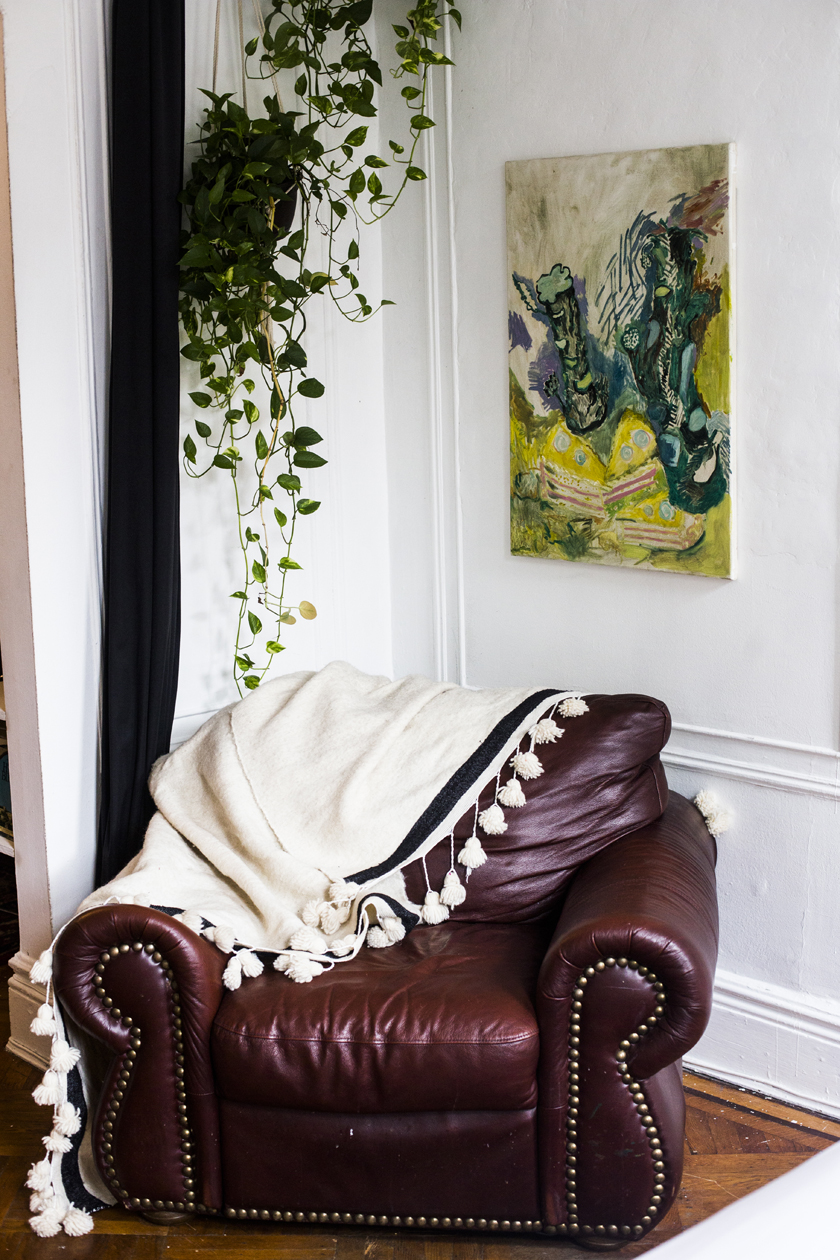 Leather armchair, vintage, found on the street. Moroccan Tassle blanket was a gift, similar  here . Painting by  Adrienne Rubenstein