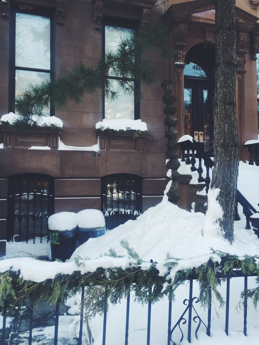 brownstone under snow