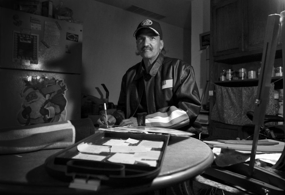 Eugene Morris drawing out a sketch for a painting while living at the Homeless Veterans Fellowship (2007).