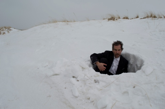 seated in snow hole.jpeg