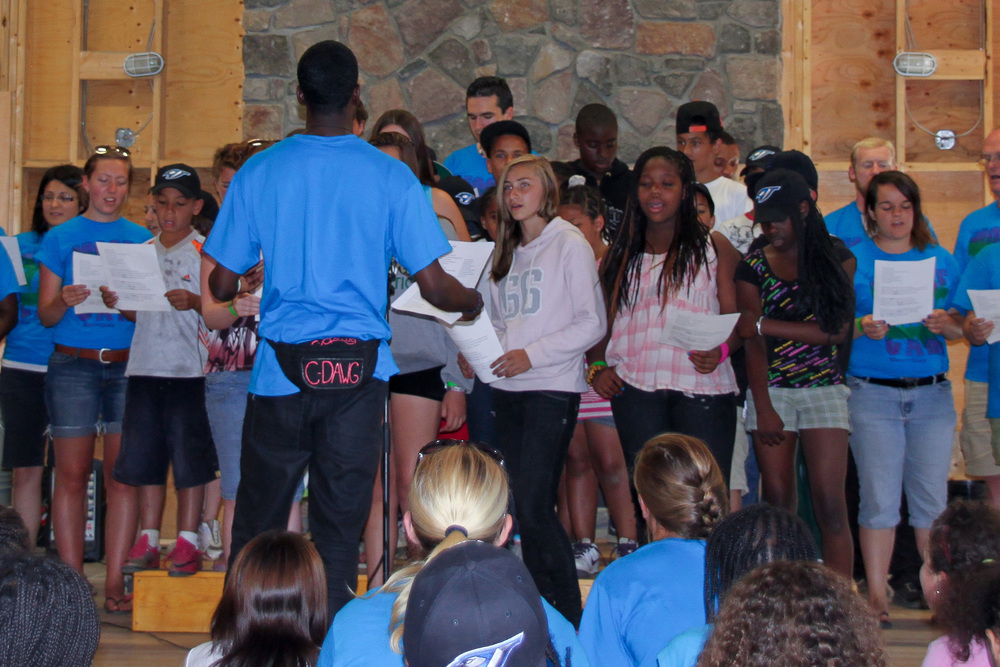 summer camp group performing a song in front of an audience