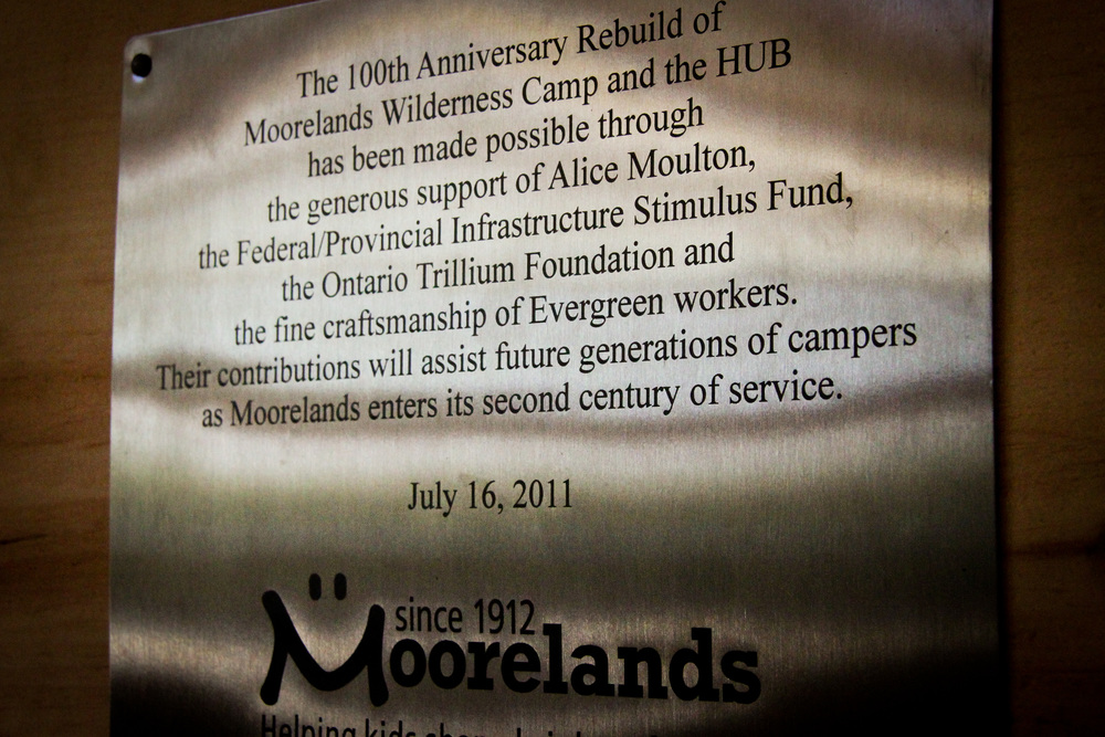 Moorelands metal plaque mentioning the 100th Anniversary rebuild of the Moorelands Wilderness Camp and the Hub