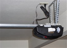 A typical garage door opener... the gear in question is on the top