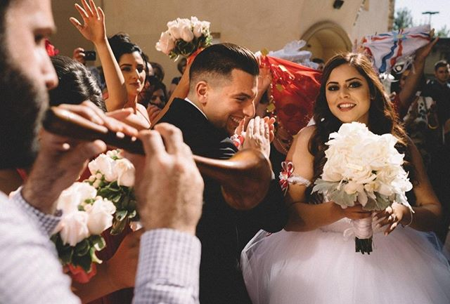 Having just been crowned as Husband and Wife, their guests and musicians parade the newlyweds out of the church. From here on, the joyful song and dance will last long into the night. . . . . . #thisisreportage #wpja #assyrianwedding #assyrianbride #documentaryweddingphotography #DWPCollective #weddingphotojournalism #storytelling #realwedding #realmoments #littlethingstheory #momentsoverposes