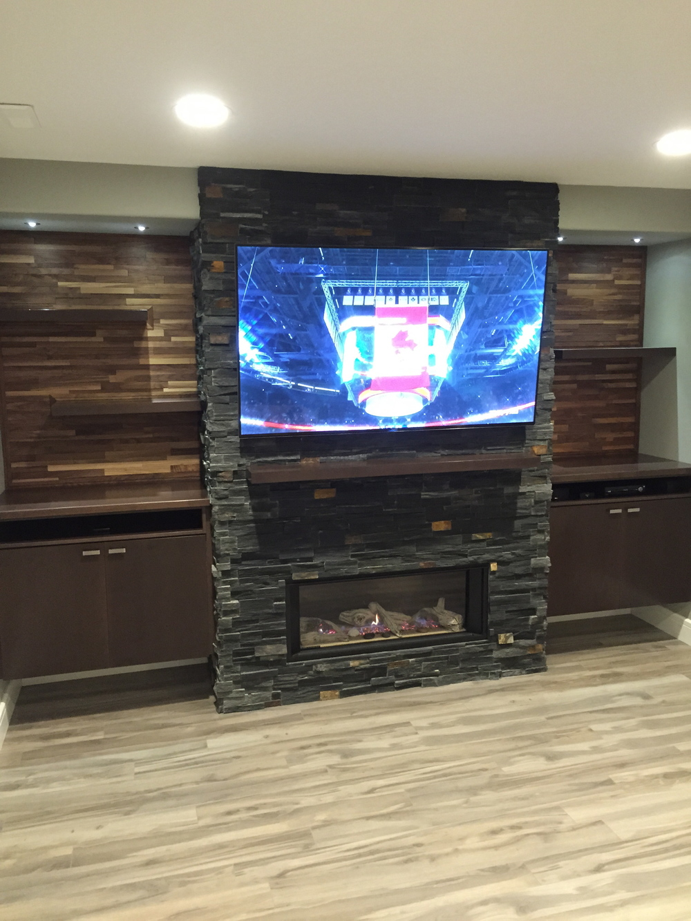 Basement renovation saskatoon, fireplace, flooring, custom shelves, trusted contractor