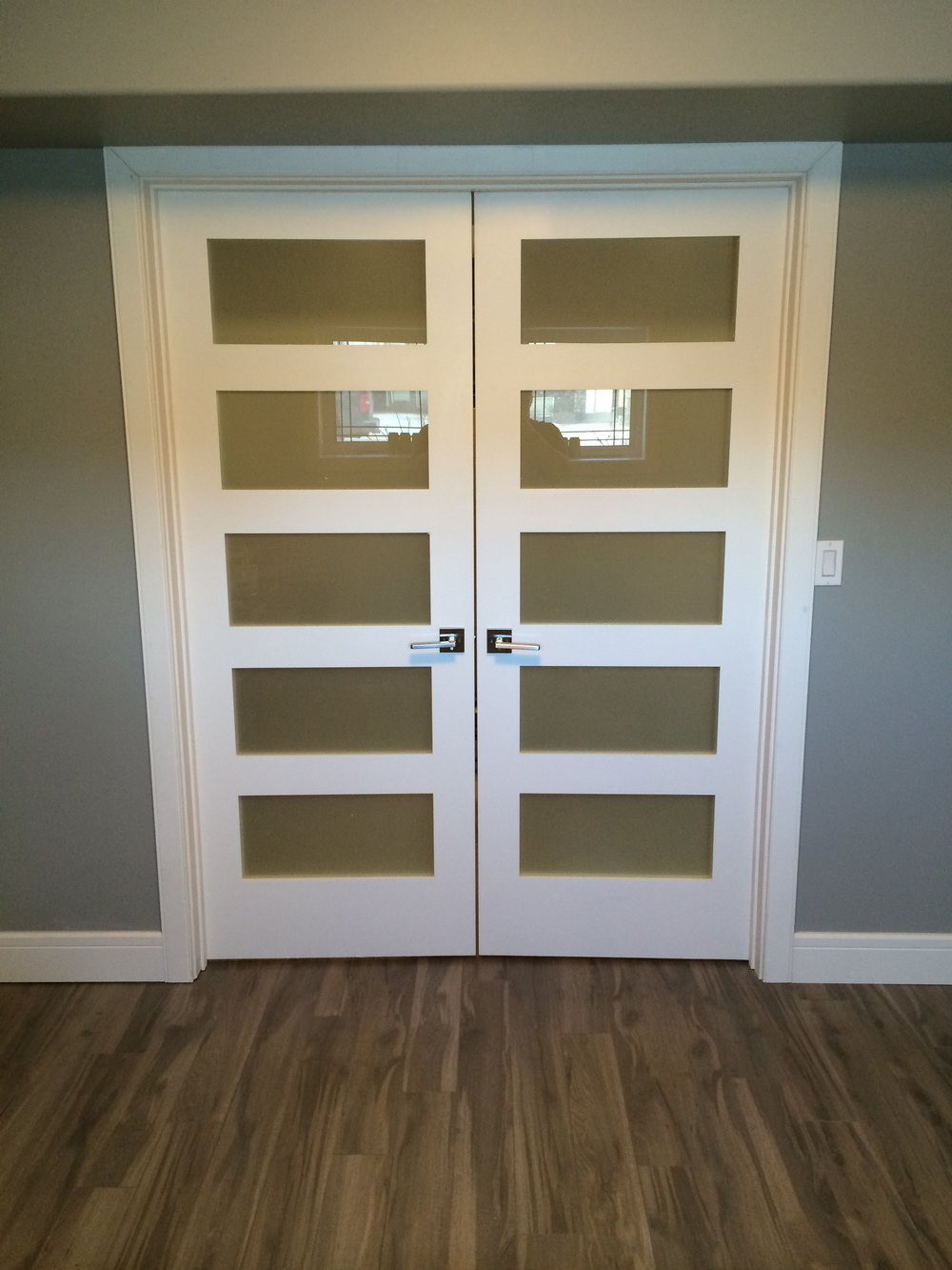 Basement renovation Saskatoon, bedroom, custom french doors, trusted contractor