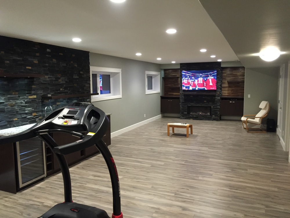 Basement renovation Saskatoon, fireplace,wet bar, stone work, flooring, trusted contractor