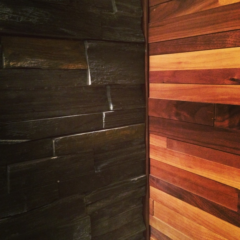 Basement renovation Saskatoon, stone work, wood panelling, custom, trusted contractor