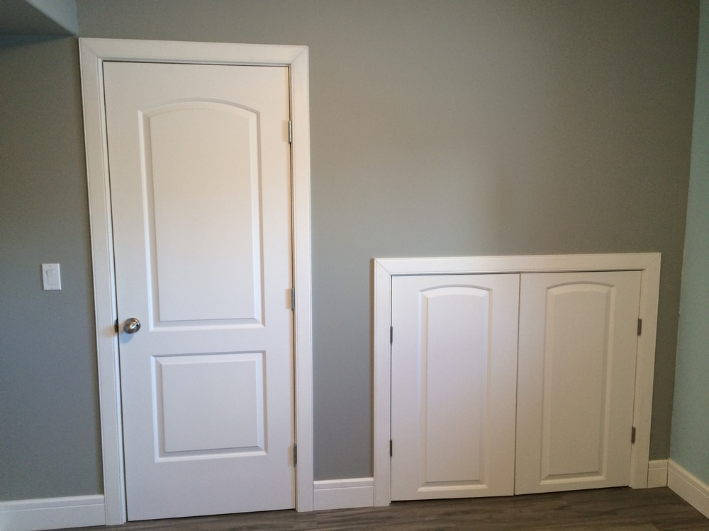 Basement renovation Saskatoon, bedroom, custom closet, french doors, flooring, trusted contractor