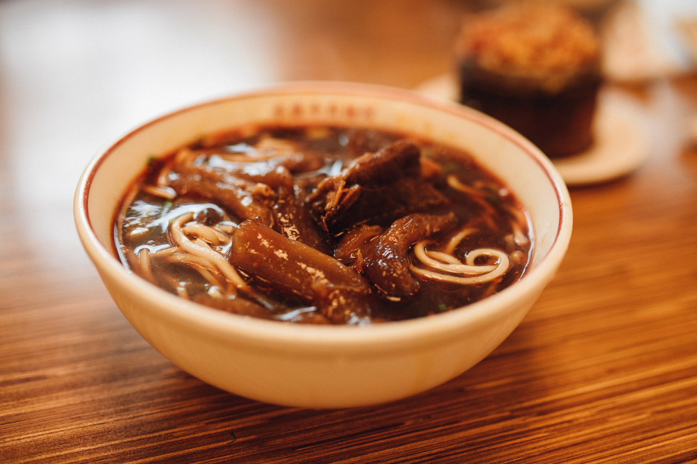 Taiwanese beef noodles and spot: sticky rice at back.