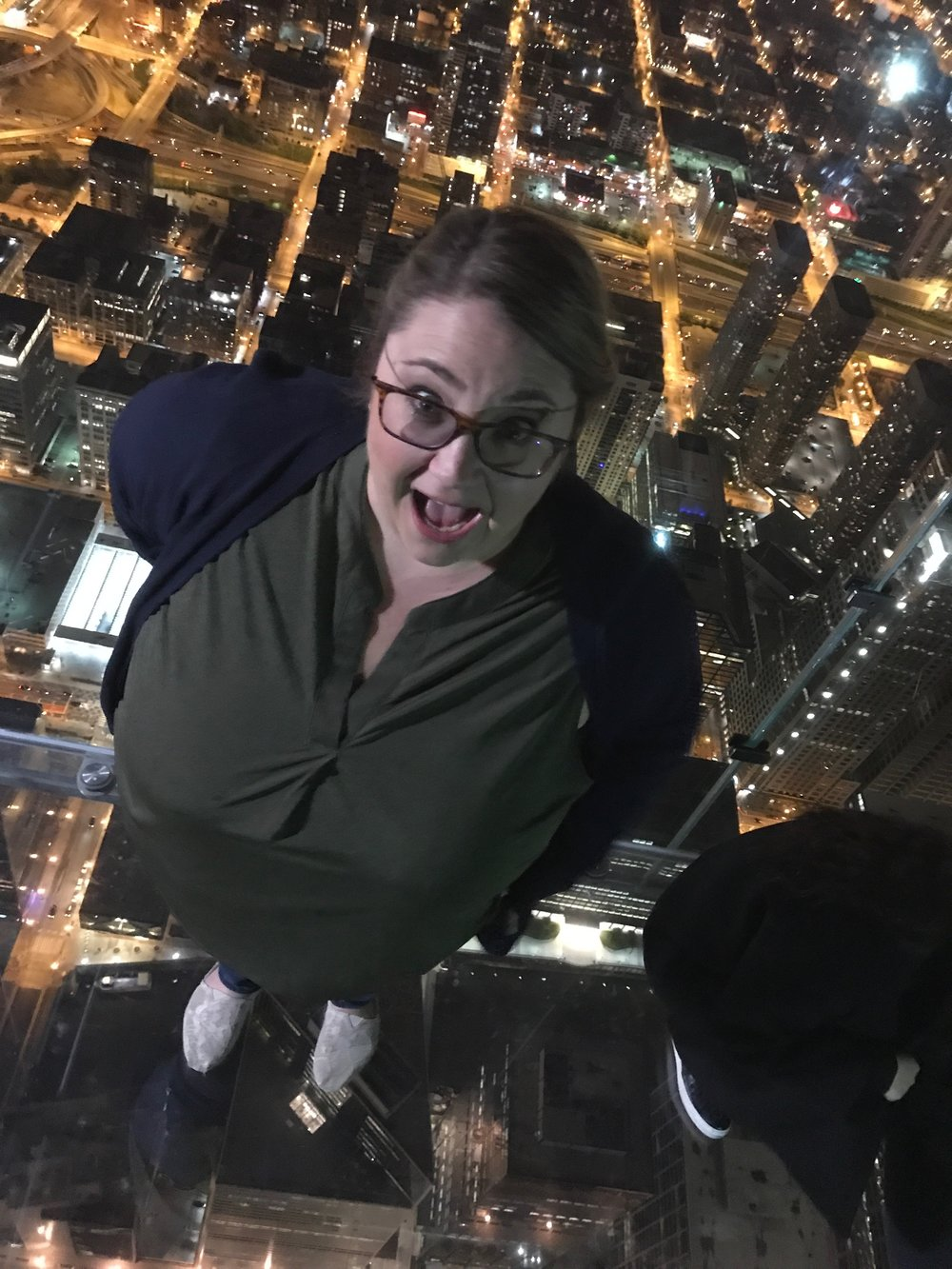 I was over 100 Floors above the ground AND standing on a glass floor.  My blood pressure was through the roof.